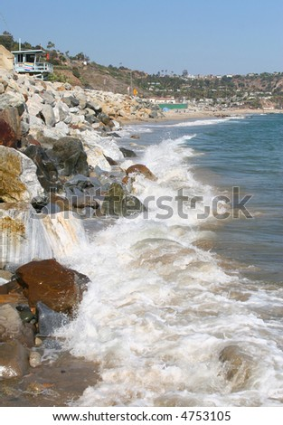 Waves crashing into the shore - stock photo