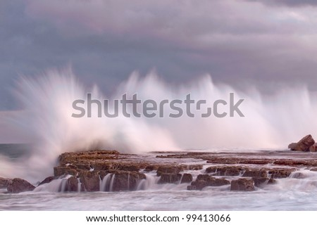 waves crashing on eastern cape coastline - stock photo