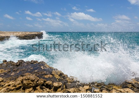 Waves Crashing on Rocks at Devil's Bridge Antigua in Sunshine - stock photo