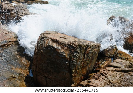 waves crashing on the rocks by the sea - stock photo