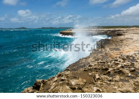 Waves Crashing over Coastline at Devil's Bridge Antigua in Sunshine - stock photo