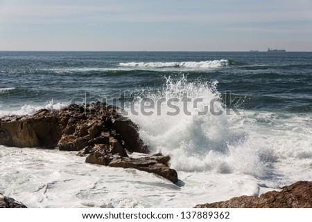 waves crashing over Portuguese Coast - stock photo