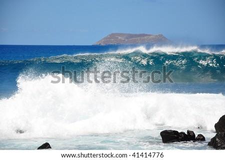 Waves crashing over stones - stock photo