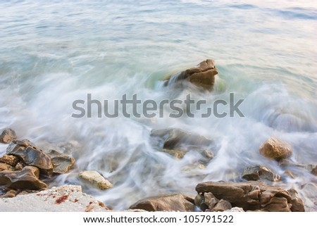 Waves crushing into the rocks - stock photo