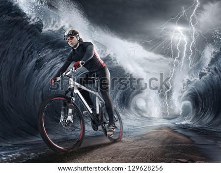waves cyclist - stock photo