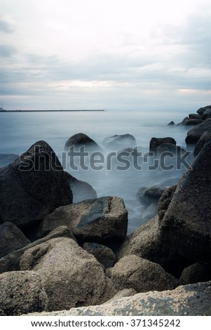 Waves gently breaking on a beach in Costa Rica - stock photo