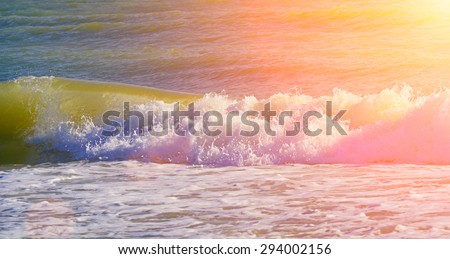 Waves in sunset light, stormy sea. Natural summer background with copy space