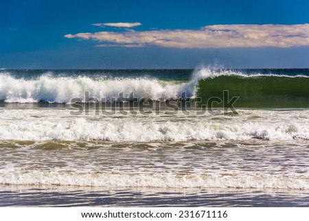 Waves in the Atlantic Ocean at Old Orchard Beach, Maine. - stock photo