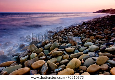 Waves lapping against rocks in Santa Barbara California - stock photo