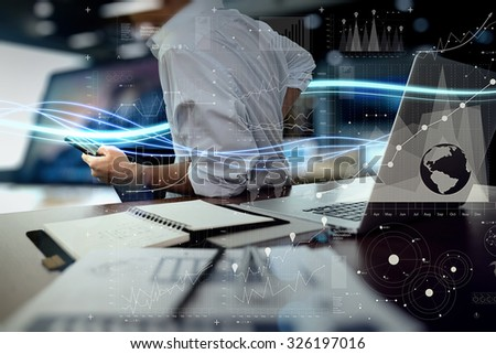 Waves of blue light and businessman using on laptop computer and smart phone with digital layer effect as concept                 - stock photo