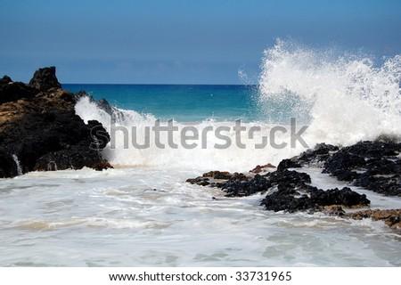 Waves on Rocks Maui - stock photo