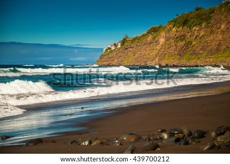 waves on the beach Playa El Socorro, Los Realejos, Puerto de la Cruz, Tenerife, Spain - stock photo