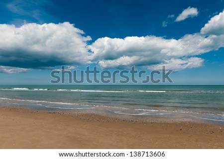 Waves on the beach, Ri-mini Italy  - stock photo