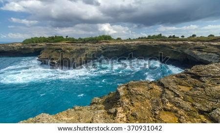 Waves on the rocks near the island of Lembongan near Bali, Indonesia - stock photo