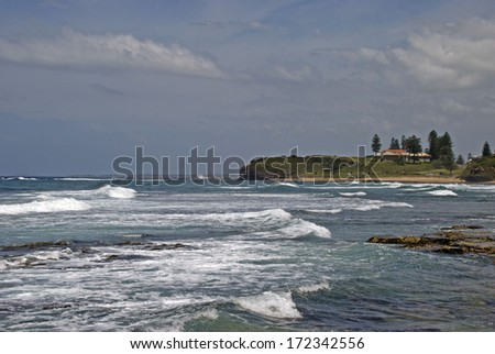 waves roll into the shoreline on Wollongong coastline - stock photo