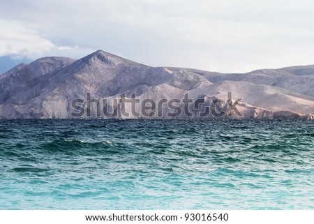 waves sweep across the beach - stock photo