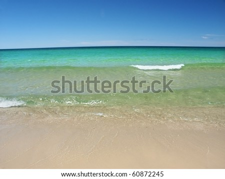 Waves wash ashore at Chapel Beach of the Pictured Rocks National Lakeshore in Michigan - stock photo