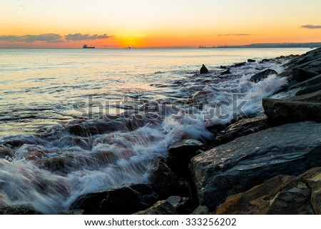 Waves with long exposure over the rocky coast side