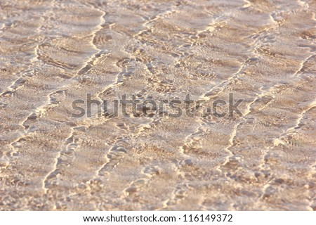 Waves with patches of light - stock photo