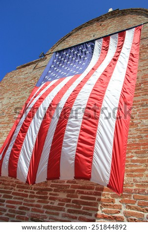 Waving American Flag on the brick wall - stock photo