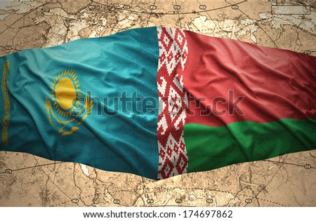 Waving Belorussian and Kazakh flags of the political map of the world - stock photo