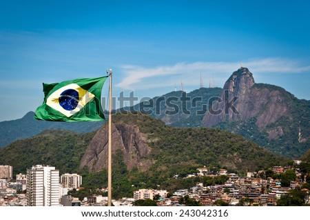 Waving Brazilian Flag with Corcovado Mountain in the Background, Rio de Janeiro, Brazil - stock photo