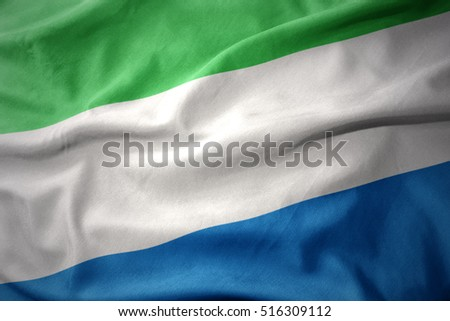 waving colorful national flag of sierra leone.