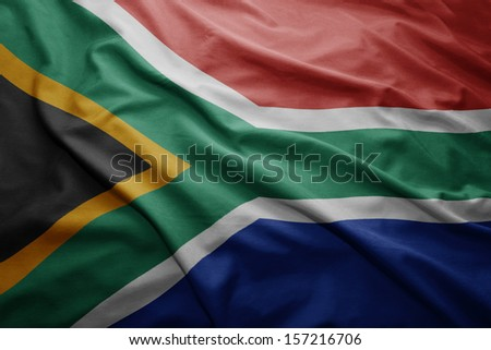 Waving colorful South Africa flag - stock photo