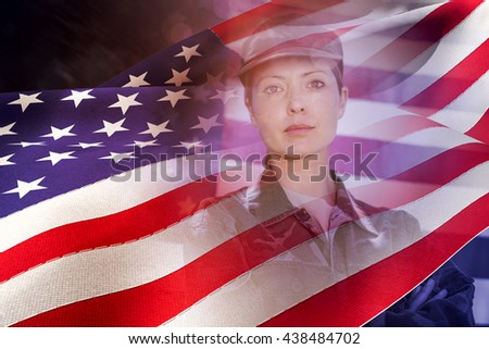 Waving flag of America against soldier standing in front of american flag