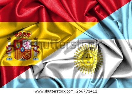 Waving flag of Argentina and Spain - stock photo