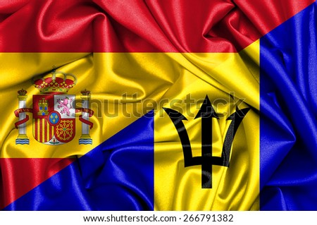 Waving flag of Barbados and Spain - stock photo