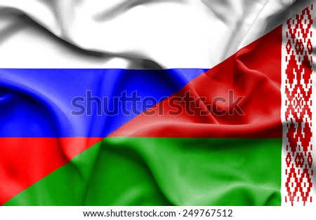 Waving flag of Belarus and Russia - stock photo