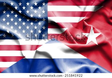 Waving flag of Cuba and USA - stock photo