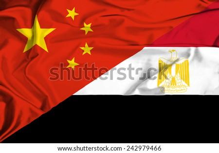 Waving flag of Egypt and China - stock photo