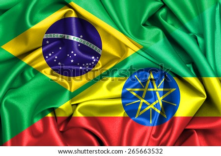 Waving flag of Ethiopia and Brazil - stock photo