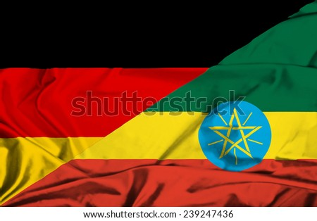 Waving flag of Ethiopia and Germany - stock photo