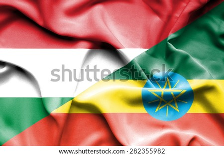 Waving flag of Ethiopia and Hungary - stock photo