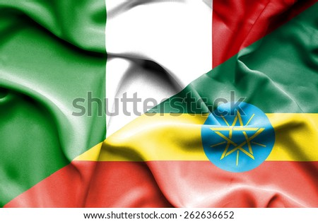 Waving flag of Ethiopia and Italy - stock photo