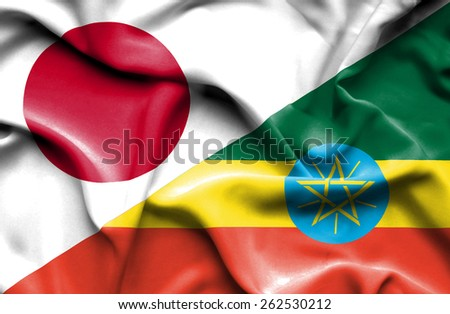 Waving flag of Ethiopia and Japan - stock photo