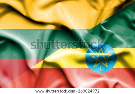 Waving flag of Ethiopia and Lithuania - stock photo