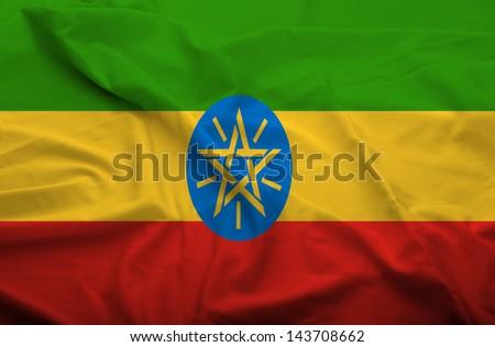 Waving flag of Ethiopia. Flag has real fabric texture.  - stock photo