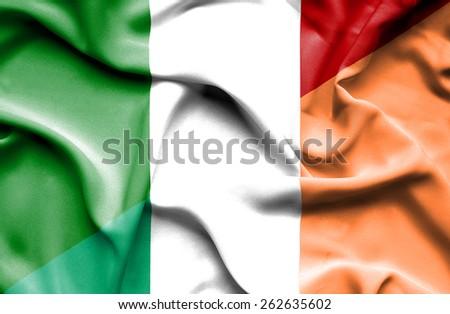 Waving flag of Ireland and Italy - stock photo