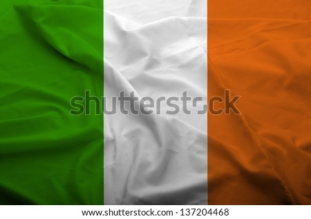 Waving flag of Ireland. Flag has real fabric texture.