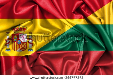 Waving flag of Lithuania and Spain - stock photo