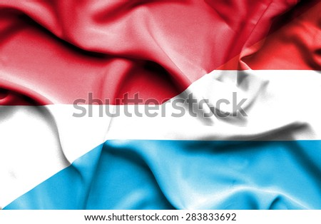 Waving flag of Luxembourg and Indonesia - stock photo