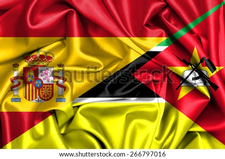 Waving flag of Mozambique and Spain - stock photo