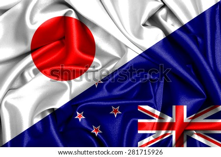Waving flag of New Zealand and Japan - stock photo