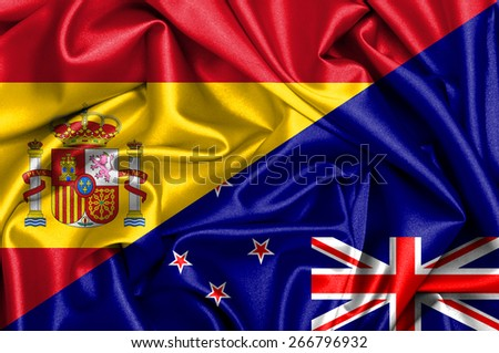 Waving flag of New Zealand and Spain - stock photo