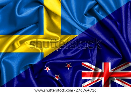 Waving flag of New Zealand and Sweden - stock photo