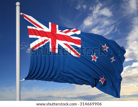 Waving flag of New Zealand on flagpole, on blue sky background.